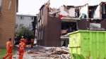 Quebec Hydro workers survey damage, in Gatineau, Que. on Sunday, September 23, 2018. Houses and Apartment buildings had roofs torn off and windows blown out and automobiles were damaged after a tornado caused extensive damage on Friday to a Gatineau neighbourhood forcing hundreds of families to evacuate their homes. THE CANADIAN PRESS/Fred Chartrand