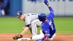 Tampa Bay Rays second baseman Joey Wendle (18) make the catch as Toronto Blue Jays shortstop Aledmys Diaz (1) is out at second during eighth inning American League baseball action in Toronto, Saturday, Sept. 22, 2018. THE CANADIAN PRESS/Frank Gunn