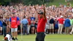 Tiger Woods celebrates after picking up his putt for par on the 18th green to win the final round of the Tour Championship golf tournament Sunday, Sept. 23, 2018, in Atlanta. (Hyosub Shin/Atlanta Journal-Constitution via AP)