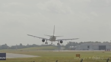 Plane aborts landing during strong winds