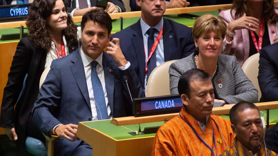 Canadian Prime Minister Justin Trudeau and International Development Minister Marie-Claude Bibeau listen to speakers at the Nelson Mandela Peace Summit opening ceremony at the United Nations Headquarters, Monday, Sept. 24, 2018. THE CANADIAN PRESS/Adrian Wyld