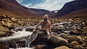 Ken Butler poses at Gros Morne's iconic tablelands in an undated handout from the 2019 merb'ys calendar. THE CANADIAN PRESS/HO-MerBys 2019, Roth and Ramberg.