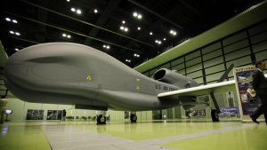 A mockup of Northrop Grumman's Unmanned Aerial Reconnaissance System plane RQ-4 Global Hawk is on display at a public exhibition hall in Tokyo, on March 24, 2010. (Junji Kurokawa / AP)