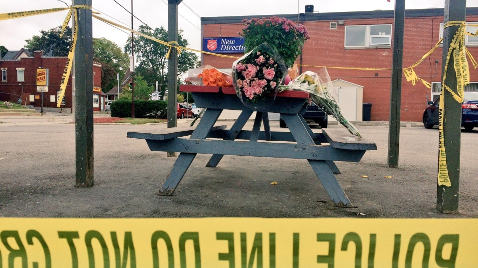 Flowers lined the picnic table where Isaiah Macnab was killed Thursday. (Dan Lauckner / CTV Kitchener)