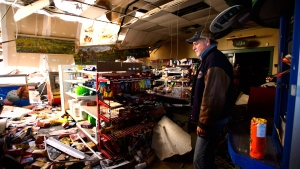 Mike Fines who is part owner of Dunrobin Meets and Deli surveys the damage to the store caused by a tornado in Dunrobin, Ont., west of Ottawa, on Monday, Sept. 24, 2018. The tornado that hit the area was on Friday, Sept, 21. THE CANADIAN PRESS/Sean Kilpatrick