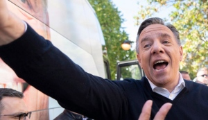 Coalition Avenir Quebec Leader Francois Legault reaches out to supporters during a campaign stop in Sainte-Anne-des Plaines, Que. on Saturday, September 22, 2018. THE CANADIAN PRESS/Paul Chiasson