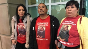 Family members of Dawns Baptiste. Louise Baptiste, left to right, Alex Baptiste and Michelle Baptiste are shown in this recent photo. THE CANADIAN PRESS/Lauren Krugel