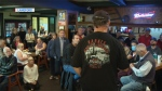 Dozens of angry neighbours showed up at Ma Miller's Pub in Langford Sunday to voice their growing frustrations over a tent city in Goldstream Provincial Park. Sept. 23, 2018. (CTV Vancouver Island)