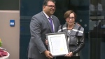 Calgary Mayor Naheed Nenshi with Annie Gale's granddaughter Sheila Yeomans.