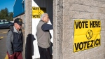 Voters arrive at a polling station to vote in the New Brunswick provincial election in Dieppe, N.B., on Monday, Sept. 24, 2018. (THE CANADIAN PRESS/Darren Calabrese)
