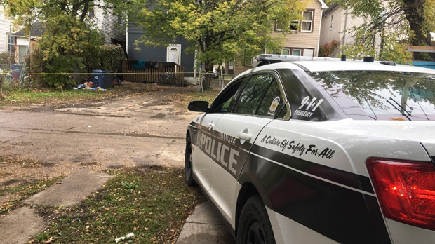 The scene of a homicide investigation is pictured from a lane in the 300 block of Pritchard Avenue, Monday, Sept. 24. (Beth Macdonell/CTV News)