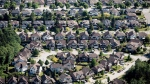 Single family homes are seen in an aerial view, in Surrey, B.C., on Wednesday May 16, 2018. THE CANADIAN PRESS/Darryl Dyck