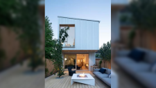 A two-storey home in East Vancouver that's selling for nearly $3 million is getting a lot of attention online for its unique shape. Located between Main and Fraser streets, the house sits on a lot that's six metres wide by 60 metres long, giving the appearance of a narrow rectangle from above. The three-bedroom, five-bathroom property boasts a study and library inside, and a private courtyard and fire pit outside. (Photos from REW.ca)
