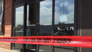 Police tape lines the entry to the LCBO in Cookstown, Ont. on Monday, September 24, 2018 following an alleged break and enter. (CTV News/Steve Mansbridge)