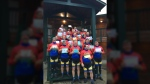 Tour De Rock riders pose for a picture in Woss with message of support from students at Hillcrest Elementary in Victoria. Sept. 24, 2018. (Twitter/@TourdeRock)