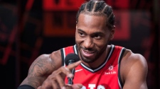 Toronto Raptors' Kawhi Leonard speaks to attends a press conference during media day in Toronto on Monday, September 24, 2018. (THE CANADIAN PRESS/Chris Young)