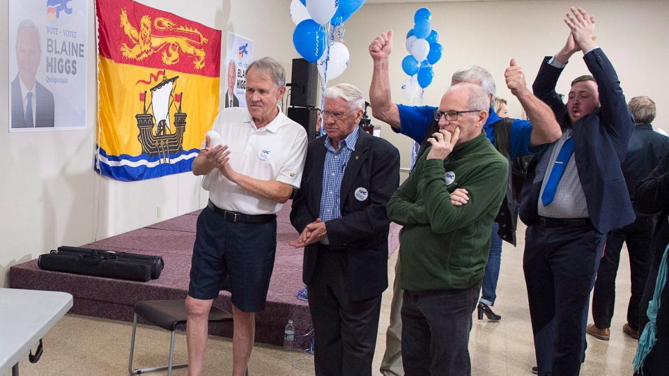 New Brunswick Progressive Conservative supporters watch early returns at leader Blaine Higgs' campaign headquarters in Quispamsis, N.B. on Monday, Sept. 24, 2018. (THE CANADIAN PRESS/Andrew Vaughan)