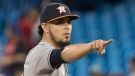Houston Astros pitcher Roberto Osuna points to the Blue Jays dugout after getting the last out to defeat his former team in the bottom of the ninth inning of their American League MLB baseball game in Toronto on Monday September 24, 2018. THE CANADIAN PRESS/Fred Thornhill
