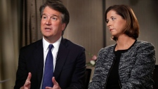 Brett Kavanaugh, with his wife Ashley Estes Kavanaugh, answers questions during a FOX News interview, Monday, Sept. 24, 2018, in Washington, about allegations of sexual misconduct against the Supreme Court nominee. (AP Photo/Jacquelyn Martin)