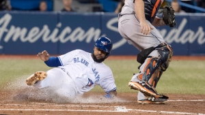 Houston Astros catcher Brian McCann gets the easy force out on Toronto Blue Jays Richard Urena at home plate in the fifth inning of their American League MLB baseball game in Toronto on Monday September 24, 2018. THE CANADIAN PRESS/Fred Thornhill