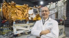 MDA's President Mike Greenley is seen in front of one of three RADARSAT Constellation Mission spacecrafts being built for the Canadian Space Agency at the company's facility in Sainte-Anne-de-Bellevue, Quebec on Tuesday January 30, 2018. With an eye on future lunar exploration, Canada's space agency is calling on companies to present their ideas for everything from moon-rover power systems to innovative mineral prospecting techniques. THE CANADIAN PRESS/Ryan Remiorz