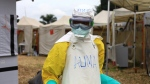 In this photo taken Sunday, Sept 9, 2018, a health worker in protective gear works at an Ebola treatment centre in Beni, Eastern Congo. The current Ebola outbreak in northeastern Congo has become a testing ground for treating confirmed Ebola victims in individual biosecure units. (AP Photo/Al-hadji Kudra Maliro)