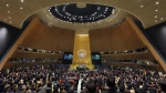 Delegates stand for a moment of silence at the start of the 73rd session of the United Nations General Assembly on Sept. 25, 2018. (Richard Drew / AP)