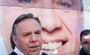 Coalition Avenir Quebec Leader Francois Legault responds to questions from reporters during a campaign stop in Sainte-Anne-des Plaines, Que. on Saturday, September 22, 2018. THE CANADIAN PRESS/Paul Chiasson