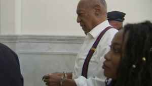 In this frame from video, Bill Cosby, centre, leaves the courtroom after he was sentenced to a three-to 10-year sentence for felony sexual assault on Tuesday, Sept. 25, 2018, in Norristown, Pa. (Pool Photo via AP)
