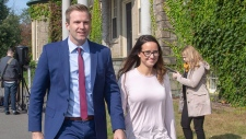 New Brunswick Liberal Leader Brian Gallant and wife Karine Lavoie, right, leave a press conference following meeting with Lieutenant Governor of New Brunswick Jocelyne Roy-Vienneau, in Fredericton on Tuesday, Sept. 25, 2018. THE CANADIAN PRESS/James West