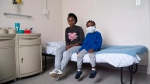 Drug-resistant tuberculosis patient Owam Sisilana, 6, and mother Siyamthanda Sisilana at the Brooklyn Chest Hospital in Cape Town, South Africa on March 14, 2018. (THE CANADIAN PRESS/Aleksandra Sagan)