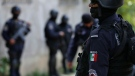 In this June 21, 2018 file photo, security forces patrol in Acapulco, Mexico. (AP Photo/Marco Ugarte)