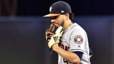 Houston Astros relief pitcher Roberto Osuna (54) runs onto the field and is met with a chorus of boos from fans during ninth inning American League baseball action against Toronto Blue Jays in Toronto, Tuesday, Sept. 25, 2018. THE CANADIAN PRESS/Frank Gunn