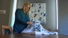 Calgary artist Jill Paddock examines the West Elm bedspread that she says resembles her painting that was on display at the retailer's Mount Royal Village location for several months