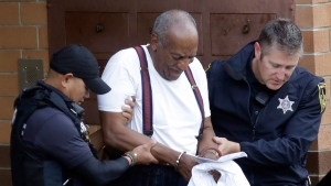 Bill Cosby is escorted out of the Montgomery County Correctional Facility Tuesday Sept. 25, 2018 in Eagleville, Pa., following his sentencing to three-to-10-year prison sentence for sexual assault. (AP / Jacqueline Larma)