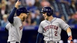 Houston Astros third baseman Alex Bregman (2) celebrates his two run homer with teammate Houston Astros center fielder George Springer (4) during first inning American League baseball action in Toronto, Tuesday, Sept. 25, 2018. THE CANADIAN PRESS/Frank Gunn
