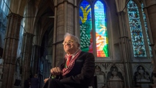 British artist David Hockney sits in front of The Queen's Window, a new stained glass window at Westminster Abbey, London, designed by David Hockney and revealed for the first time on Wednesday Sept. 26, 2018. (Victoria Jones/Pool via AP)