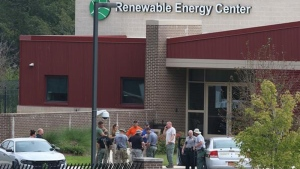 Law enforcement officials gather outside the Renewable Energy Center across from the Gaston County Landfill near Dallas, N.C., Tuesday, Sept. 25, 2018, as the search continues for missing 6-year-old Maddox Ritch, who vanished from Rankin Lake Park in Gastonia last Saturday. (Mike Hensdill/The Gaston Gazette via AP)