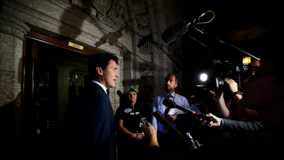 Prime Minister Justin Trudeau pauses to talk to reporters as he makes his way into the House of Commons on Parliament Hill in Ottawa on Wednesday, Sept. 26, 2018. THE CANADIAN PRESS/Sean Kilpatrick