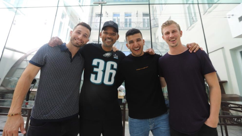 "Members of YouTube channel ""Yes Theory"", from left to right, Matt Dajer, Ammar Kandil and Thomas Brag pose for a photo with actor Will Smith in an undated handout photo. (THE CANADIAN PRESS/HO-Yes Theory)"