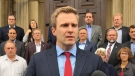 New Brunswick Premier Brian Gallant speaks to reporters in front of the provincial legislature in Fredericton on Wednesday, September 26, 2018. THE CANADIAN PRESS/Kevin Bissett