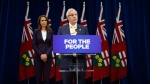 Ontario's Minister of Finance Vic Fedeli and Attorney General Caroline Mulroney speak about new legislation for selling marijuana, in Toronto, Wednesday September 26, 2018. (THE CANADIAN PRESS/Mark Blinch)