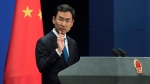 Chinese Foreign Ministry spokesman Geng Shuang gestures as he speaks during a daily briefing at the Ministry of Foreign Affairs office in Beijing, Monday, Sept. 4, 2017. (AP Photo/Andy Wong)