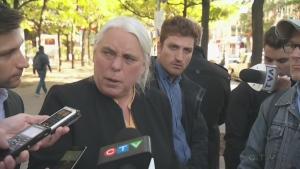 Manon Massé talks to reporters