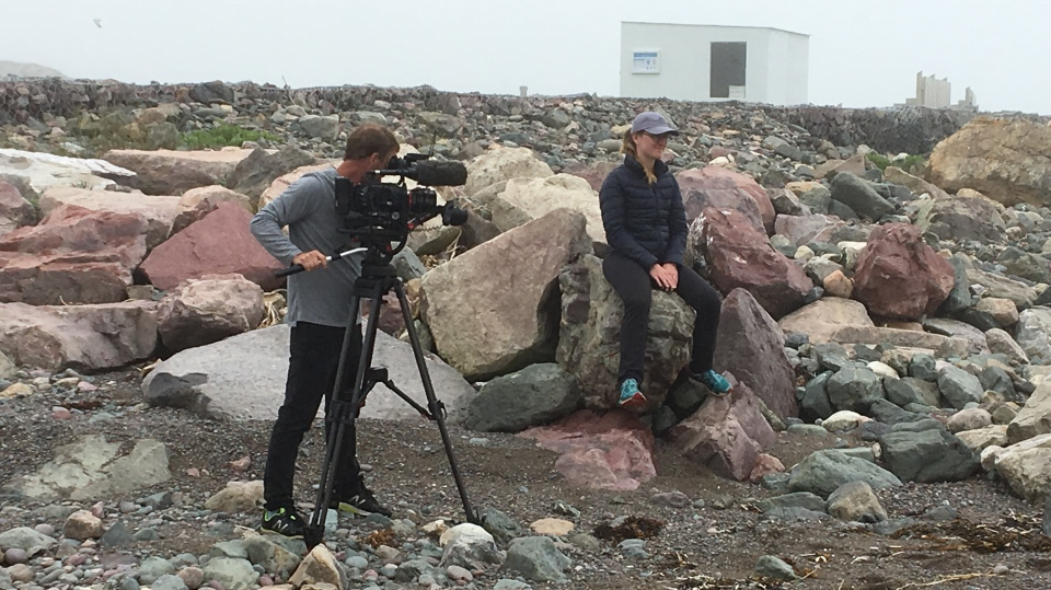 W5 cinematographer Jerry Vienneau gets a close-up of Saint-Pierre et Miquelon's summer lifeguard, Marie Cormier.