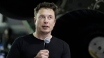 In this Sept. 17, 2018, file photo SpaceX founder and chief executive Elon Musk speaks after announcing Japanese billionaire Yusaku Maezawa as the first private passenger on a trip around the moon in Hawthorne, Calif. (AP Photo/Chris Carlson)