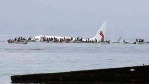 This photo provided by Blue Flag Construction shows an Air Niugini plane floating in Pacific lagoon after its crash-landing in Pacific lagoon near Chuuk Airport in Weno, Federated States of Micronesia, Friday, Sept. 28, 2018. All of the passengers and crew survived the crash landing. (Blue Flag Construction via AP)