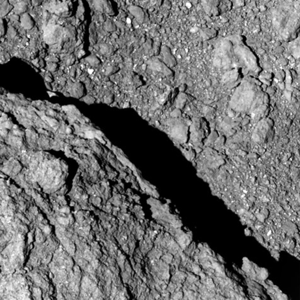 This Sept. 21, 2018 image taken at an altitude of approximately 64 metres by Hayabusa2 shows the surface of asteroid Ryugu. (JAXA, The University of Tokyo and partner institutions via AP)