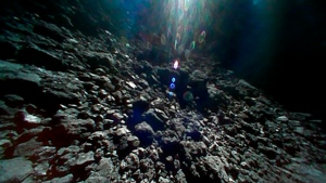 This Sept. 23, 2018 image captured by Rover-1B, and provided by the Japan Aerospace Exploration Agency (JAXA) shows the surface of asteroid Ryugu. (JAXA via AP)