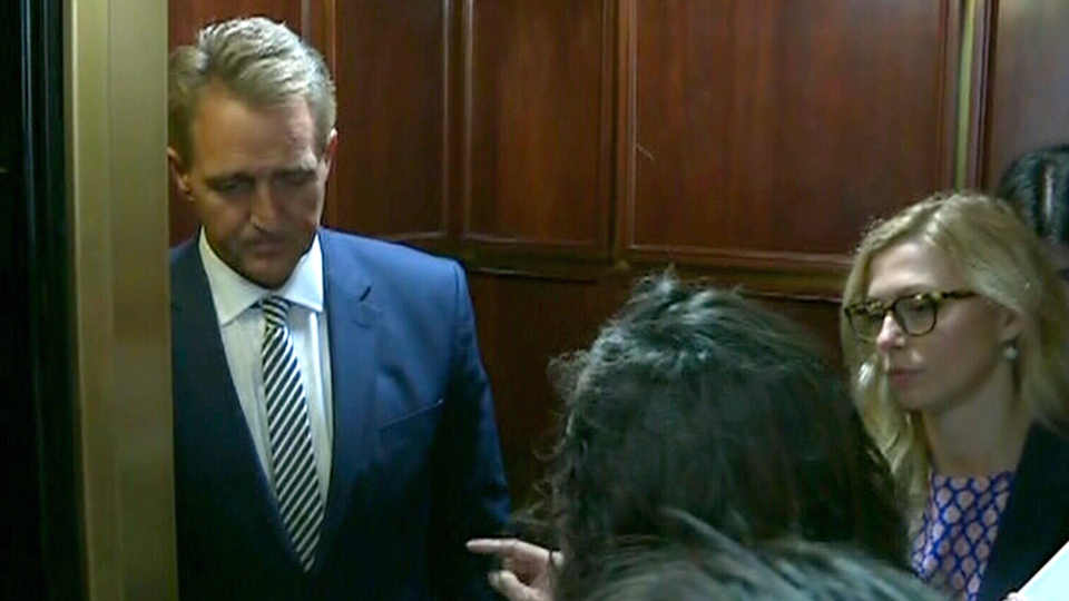 Protesters confronted Jeff Flake in a Capitol Hill elevator on his way to the hearing and pleaded with him to change his mind.